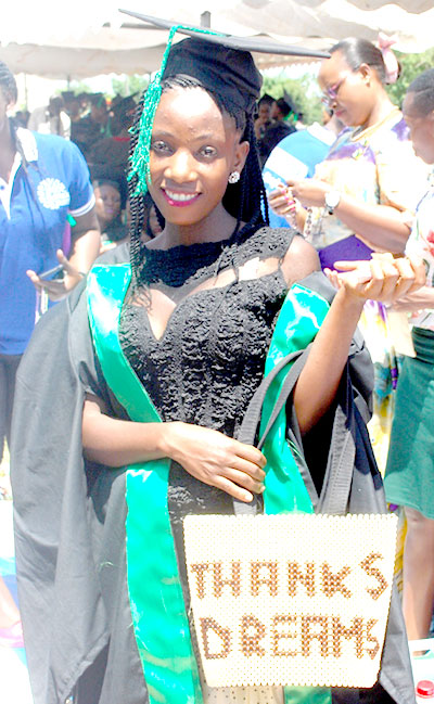 A graduand holds a bag she designed with inscription of DREAMS.These are some of the craft skills the students got.