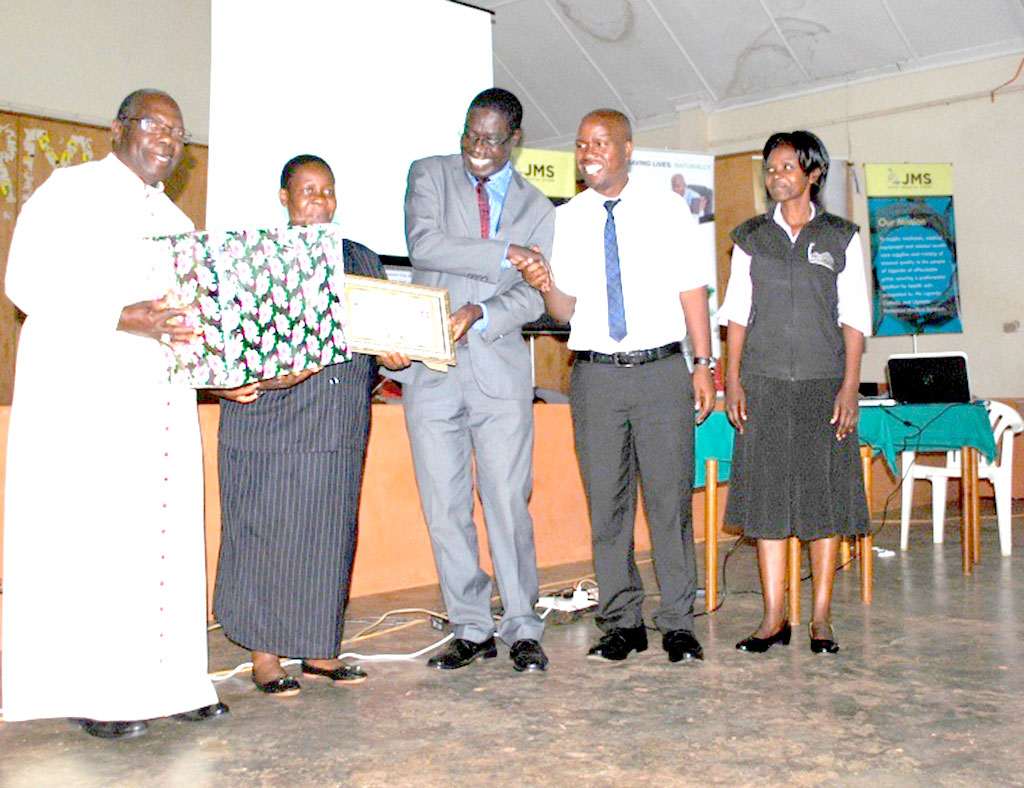 Kitovu Mobile's Jane Katerega being recognised as one of the outstanding employees in the Diocesan Health Department. As a nurse, she has worked with Kitovu Mobile for two decades.