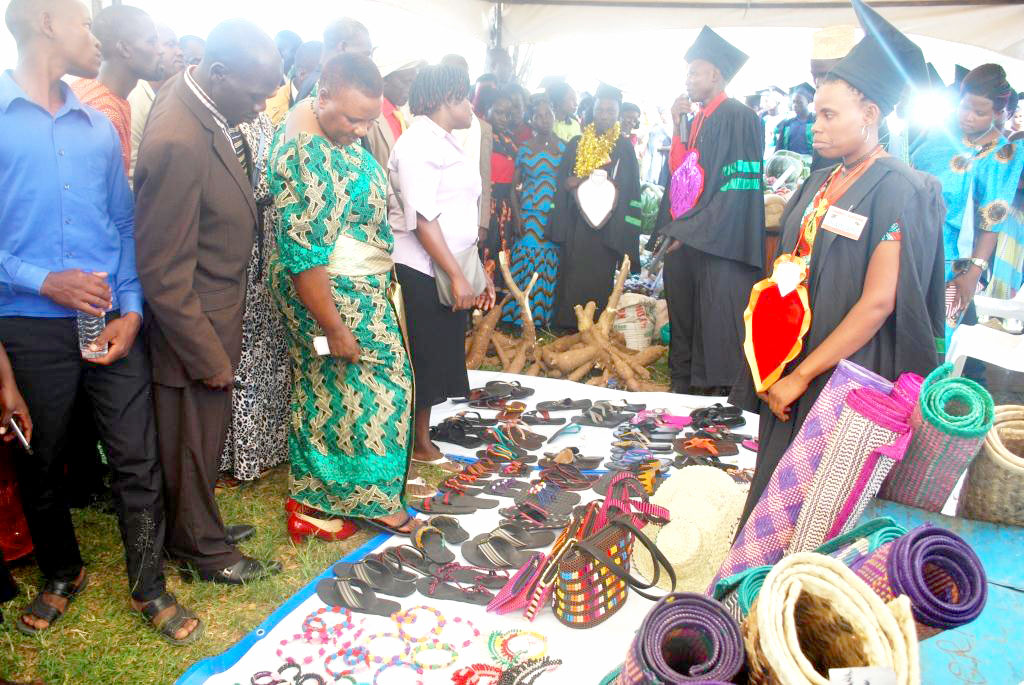 Kyotera Woman MP Ms Sentongo(Green gomesi) mesmerised by the shoes made by the craft students.
