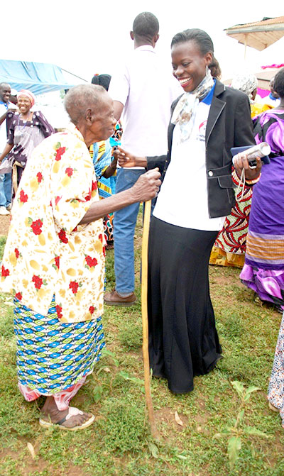 LIGHT MOMENT: A counsellor for Grandmothers, shares a moment with one of the project beneficiaries.