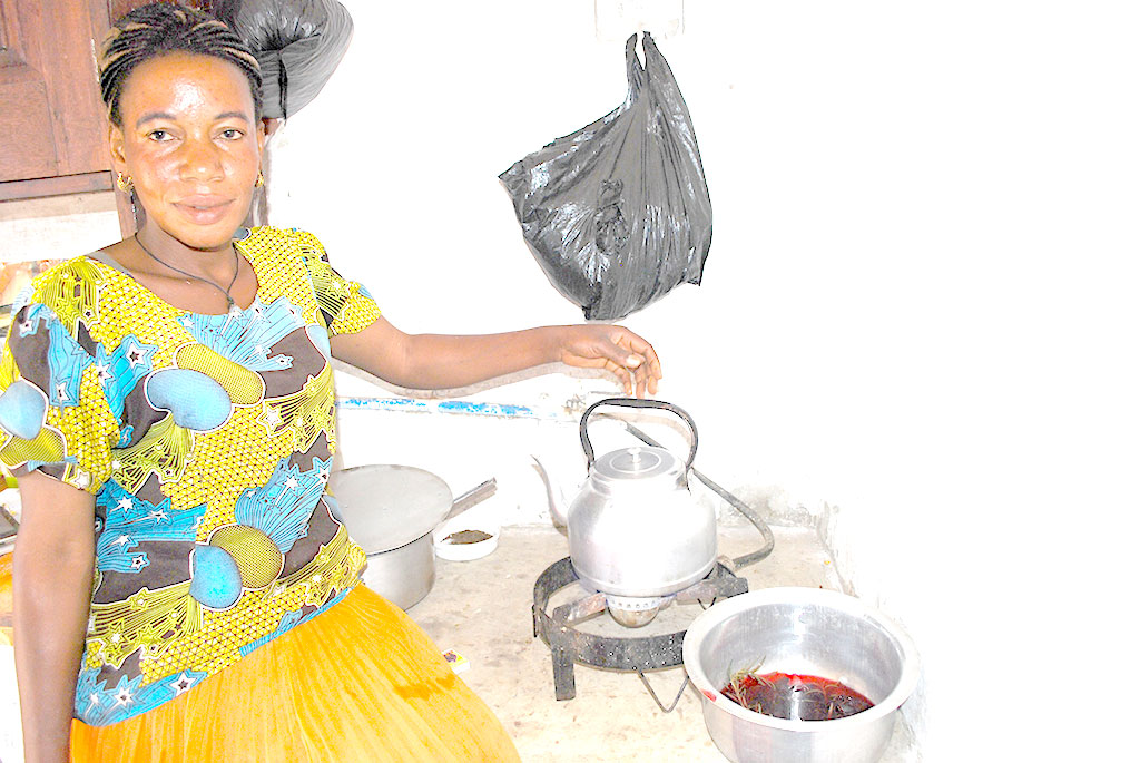 Nasamula in her kitchen. She uses bio gas which has eased cooking at her home . KITOVU MOBILE PHOTOS
