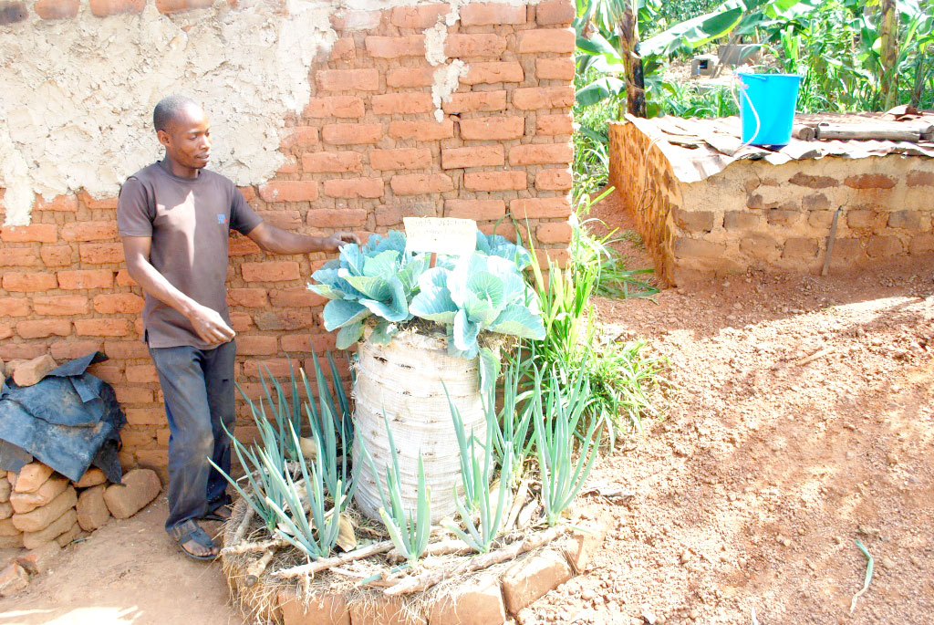 Sebowa showing off some of his vegetable gardens. KITOVU MOBILE PHOTOS