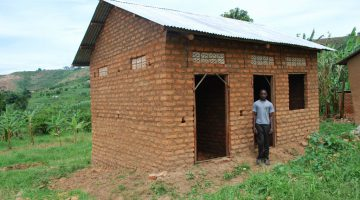 A two roomed house which Sebyoto has just constructed. He used proceeds from selling crops to buy the plot of land also build the house