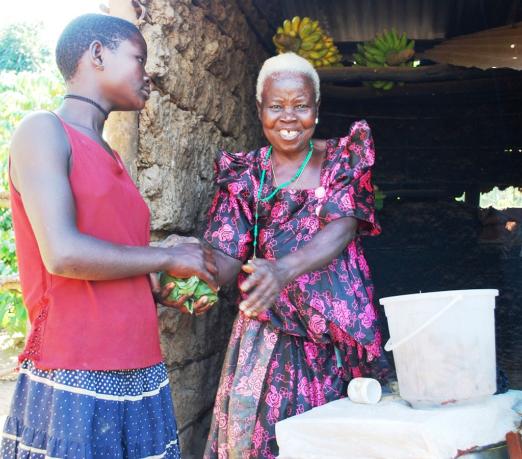 Jolly Namatovu attending to her customer.She says her livelihood has tremendously improved .