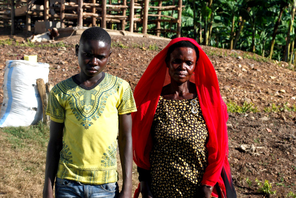 Lwebuga and his mother,Mrs Katongole pose for as photo.His mother was worried on what to do for her son,but Kitovu Mobile offered a lasting solution