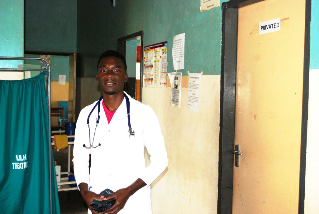 Matovu gets ready for an evening shift at Vila Maria Hospital,the devoted health worker says he wants to thank God by taking good care of patients.