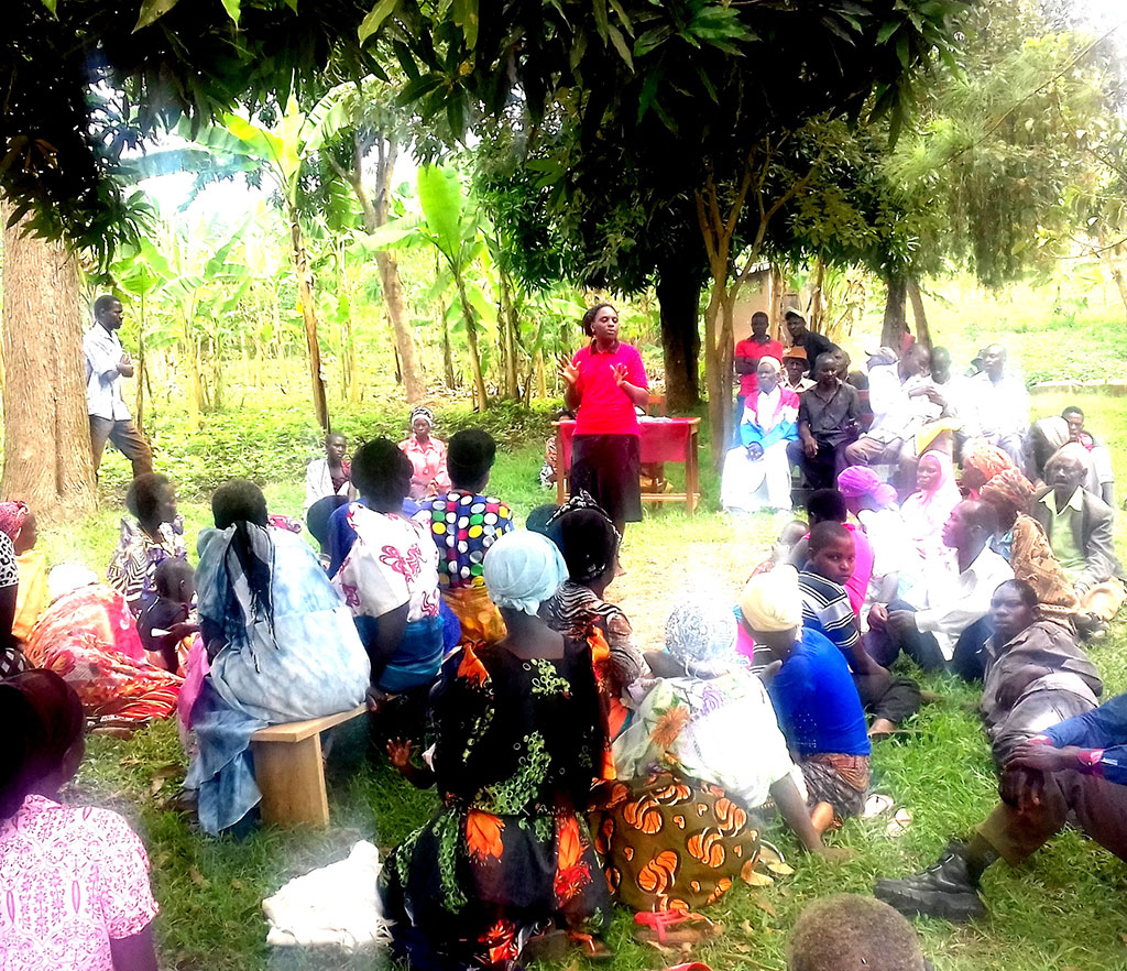 Ms Namulondo(In red t-Shirt) sensitising residents in Kagamba Town , Rakai District.