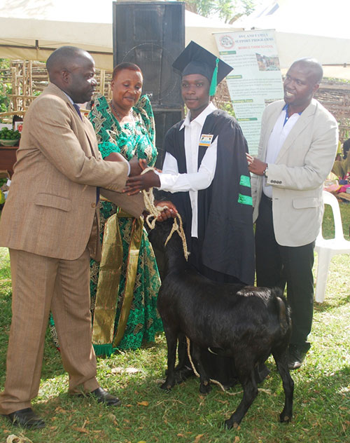 Sebyoto recieves a goat for braving difficulties and complete the course as well as making good use of the skills to transform his livelihood.