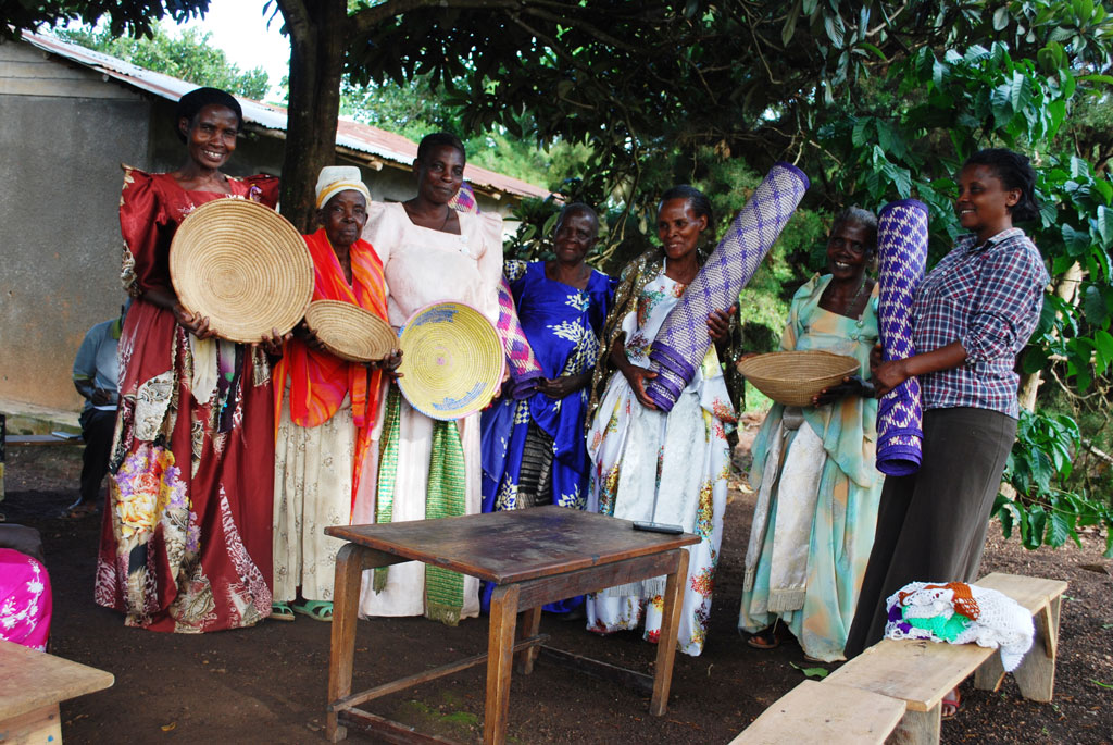 Grand mothers with some of the crafts they make to get money for saving.