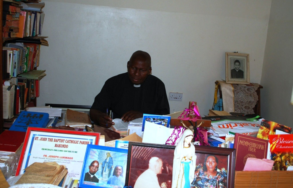 Fr Lukwago in his office at Villa Maria Parish,Kalungu District
