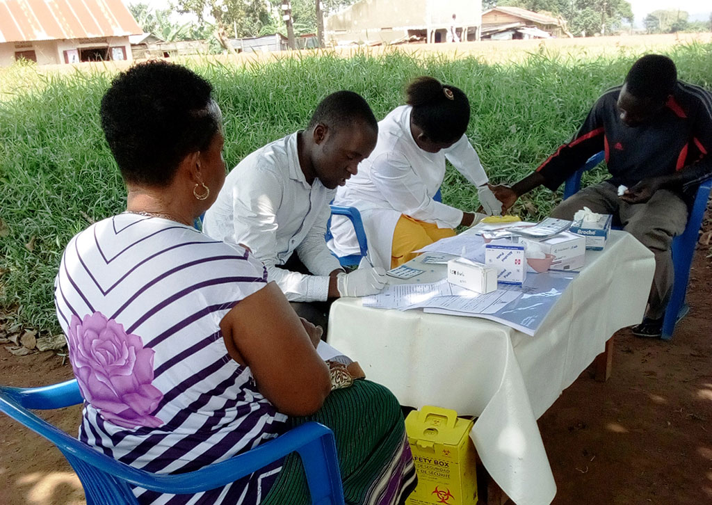 Kitovu Mobile Medical Team,carrying out HIV testing during one of its outreaches. HIV testing is the first 90,which leads to the other 90s and its success paves way for the other.