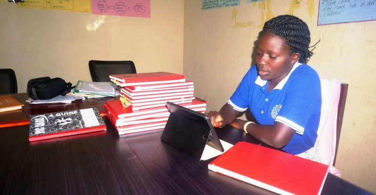 Ms Nampebewa in her office at Kagamba Safe space where she works as a data entrant
