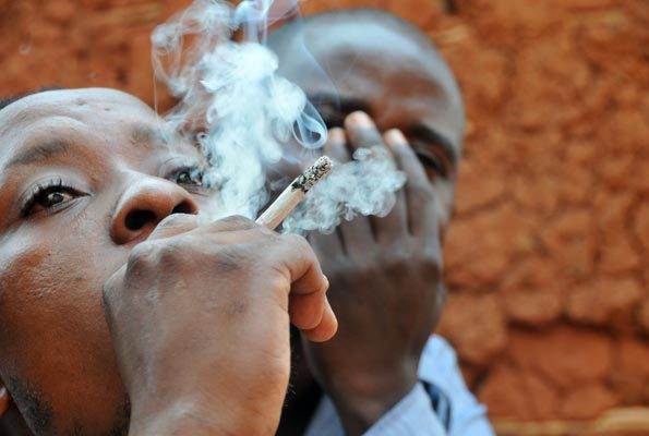 A daily Monitor's photo captures a man smoking