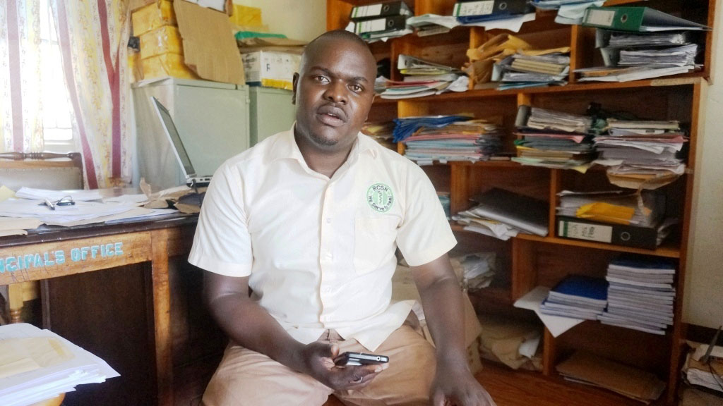 Dr Kayiira in his office at Rakai Community School of Nursing where he works as the academic registrar