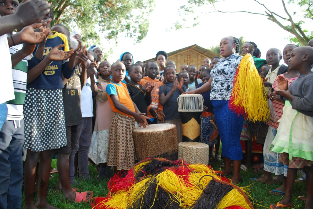 Ms Sharon Nambasa hands over traditional music instruments for recreational  activities