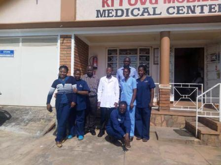 Kitovu Mobile Medical Center staff pose for a group photos with MoH and UCMB officials