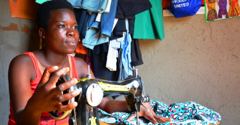 Nanyondo doing what she does best. Her sewing machine tailors her livelihood. PHOTO BY MOSES MUWULYA