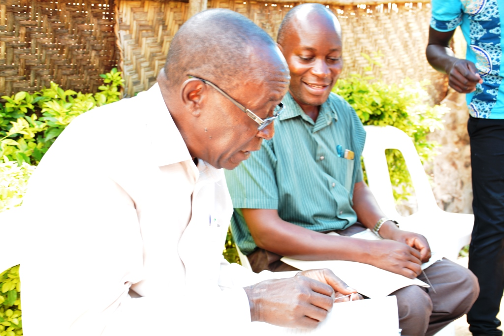 Mr Bagarukayo joining quires to form a book