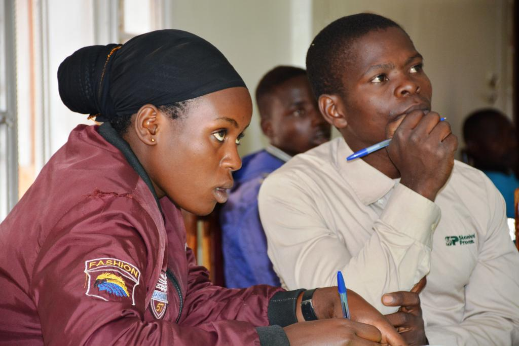 Attentive: Trainees keenly listening to the facilitator