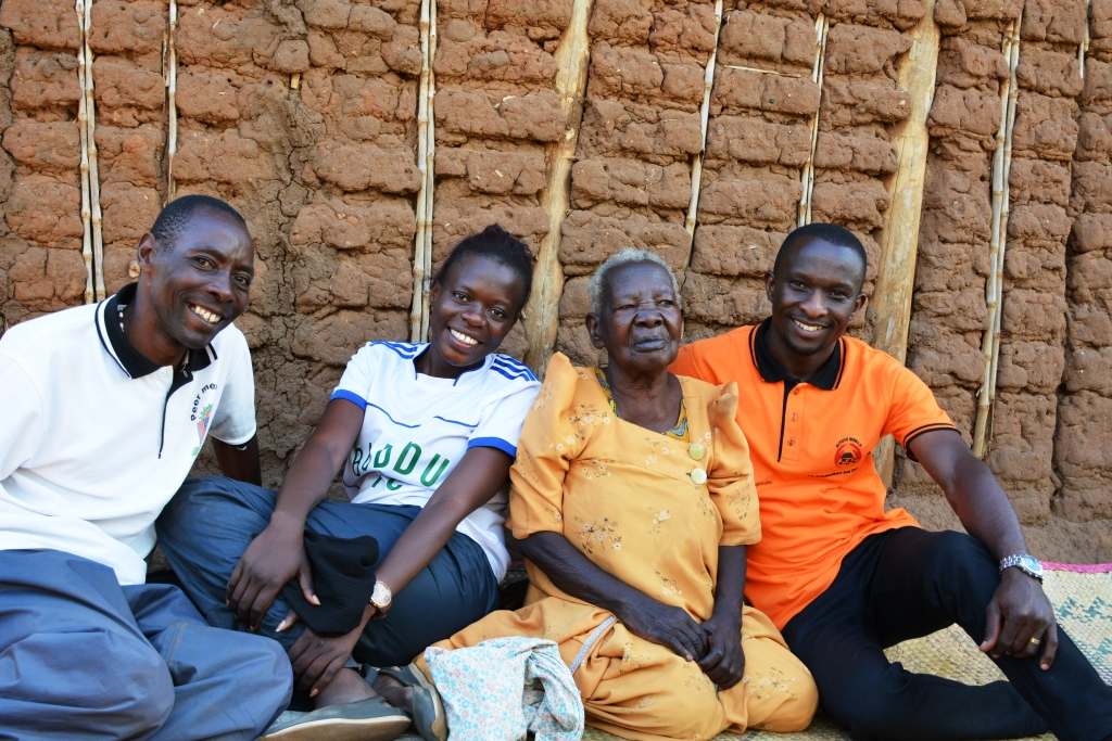 The grandmothers and OVC social support project team pose for a photo with Namusu.