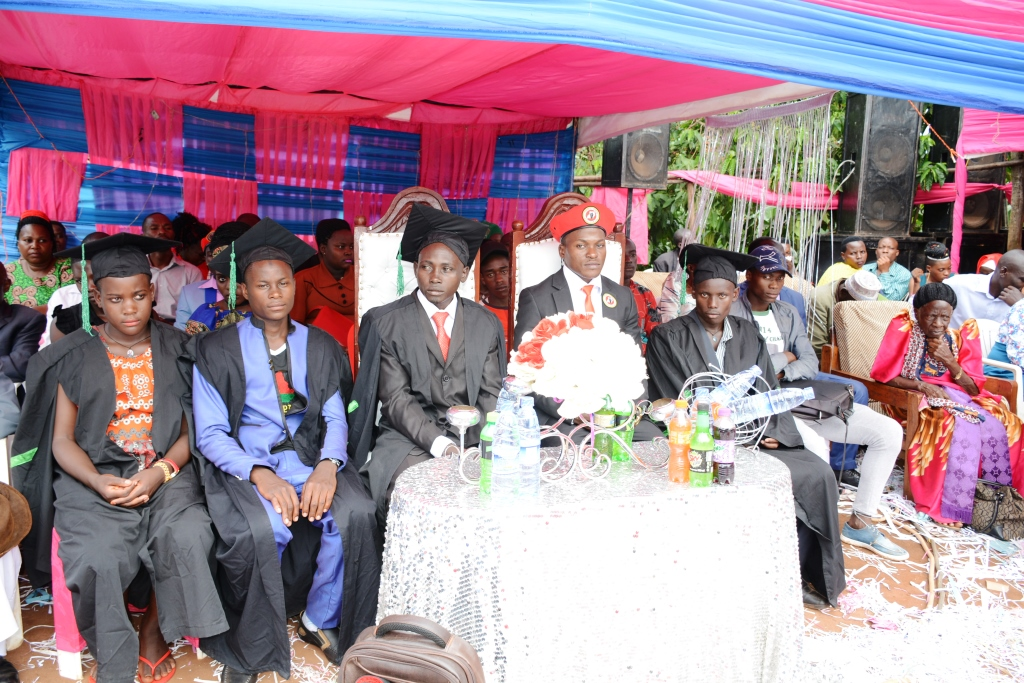 Lubega (third right) with some Mobile Farm School Graduates whom he invited to grace hisA ceremony.