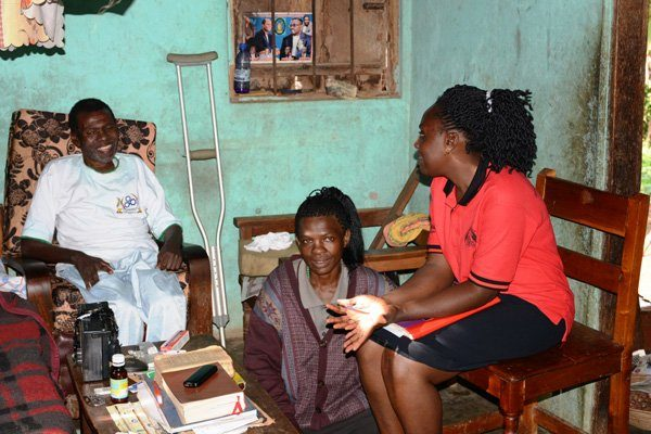 Kitovu Mobile Palliative care nurse (right) on home care visit to Lubega's home. PHOTO BY WILSON KUTAMBA